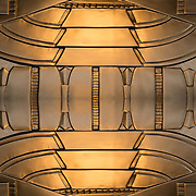 The Art Deco decorations are bronze grillwork above door entrance on building  at 34th Street and 8th Avenue in NYC.