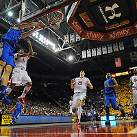16 February 2013:   Duke Blue Devils forward Mason Plumlee (5) scores on a dunk in action against Maryland Terrapins guard Seth Allen (4) at the Comcast Center in College Park, MD.