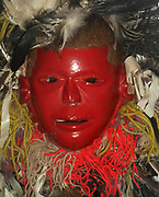 Late 20th century wood, paint, feathers, metal and wool mask from the Chewa people in Malawi. With the red face mask it represents the well-known chief of a neighbouring group.  In Chewa masquerade outsiders are classed as 'creatures of the bush' like wild animals. The Chewa are a people of Central and Southern Africa. The Chewa are closely related to people in surrounding regions such as the Tumbuka and Nsenga. They are historically also related to the Bemba, with whom they share a similar origin in the Democratic Republic of the Congo.