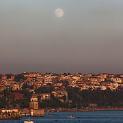 Full moon over the Bosphorus Strait in Istanbul, Turkey. Cityscape show the Asian side of the city.