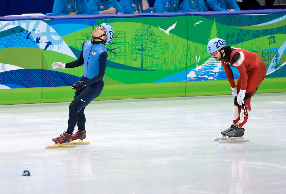US short track speed skater Apolo Ohno (L) reacts after winning the bronze medal in the 1,000m final to earn his 7th Olympic medal, making him the most decorated U.S. Winter Olympic athlete in history.