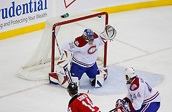 Jan 2, 2009; Newark, NJ, USA; New Jersey Devils center Brian Rolston (12) hits the crossbar over the shoulder of Montreal Canadiens goalie Marc Denis (38) during the third period at the Prudential Center.  The Devils defeated the Canadiens 4-1.