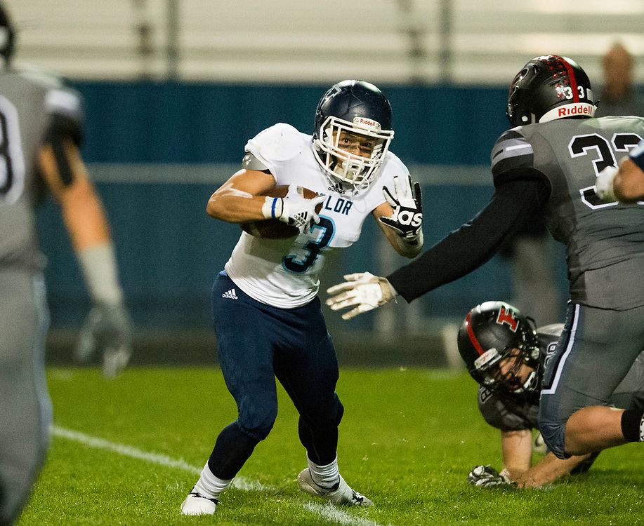 ARVADA - SEPT. 22: Valor Christian's Jadin Watson looks for an opening past Pomona's Kyle Moretti during the second half of a Class 5A nonconference high school varsity football game held at the North Area Athletic Complex. (Photo by Andy Colwell/ Special to The Denver Post)