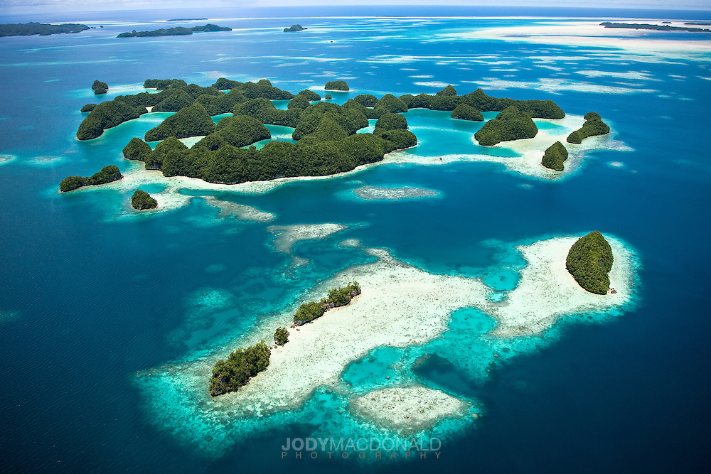 The amazing colors and incredible natural beauty of the 70 islands in Palau can only be seen by helicopter or plane.  In an uncommon and very forward-thinking move the local government moved to protect the islands from man's destruction over 4 decades ago.  One of earth's first marine parks.