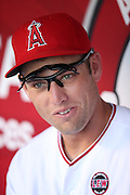 ANAHEIM, CA - AUGUST 21:  Peter Bourjos #25 of the Los Angeles Angels of Anaheim looks on from the dugout during the game against the Cleveland Indians on Wednesday, August 21, 2013 at Angel Stadium in Anaheim, California. The Indians won the game 3-1. (Photo by Paul Spinelli/MLB Photos via Getty Images) *** Local Caption *** Peter Bourjos