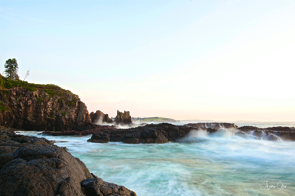 Cathedral Rocks Kiama NSW. hese volcanic rocks, while intensely hard, have many joints. These joints have been eroded for many years