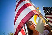 "10 SEPTEMBER 2011 - TEMPE, AZ:     JACQUELYN POWER, from Tempe, AZ, looks at the flags in the ""Healing Field"" in Tempe, Saturday. The ""Healing Field,"" a display of 2,996 flags, one for each person killed in the September 11 terrorists attacks on the World Trade Center in New York City and Washington DC, have become an annual tradition in Tempe, AZ. The event is sponsored by the National Exchange Club.    PHOTO BY JACK KURTZ"