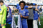Chelsea Midfielder Willian (22) celebrates with the trophy during the Premier League match between Chelsea and Sunderland at Stamford Bridge, London, England on 21 May 2017. Photo by Andy Walter.