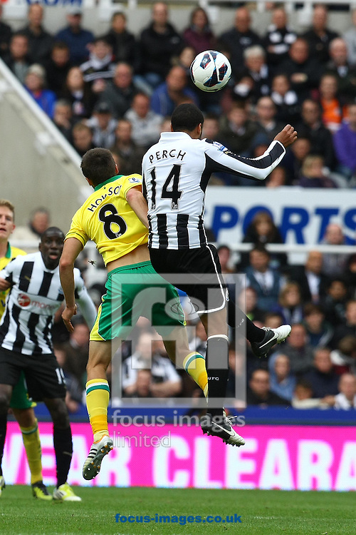 Picture by Paul Chesterton/Focus Images Ltd +44 7904 640267.23/09/2012.Jonny Howson of Norwich and James Perch of Newcastle in action during the Barclays Premier League match at the Sports Direct Arena, Newcastle.
