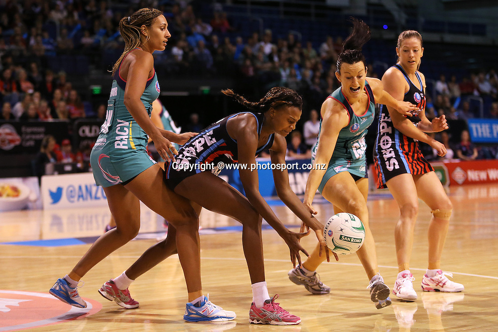 Mwai Kumwenda of the Tactix and Bianca Chatfield of the Vixens compete for the ball during the ANZ Championship Netball between Mainland Tactix v Melbourne Vixens, held at CBS Arena, Christchurch. 31 March 2014 Photo: Joseph Johnson/www.photosport.co.nz