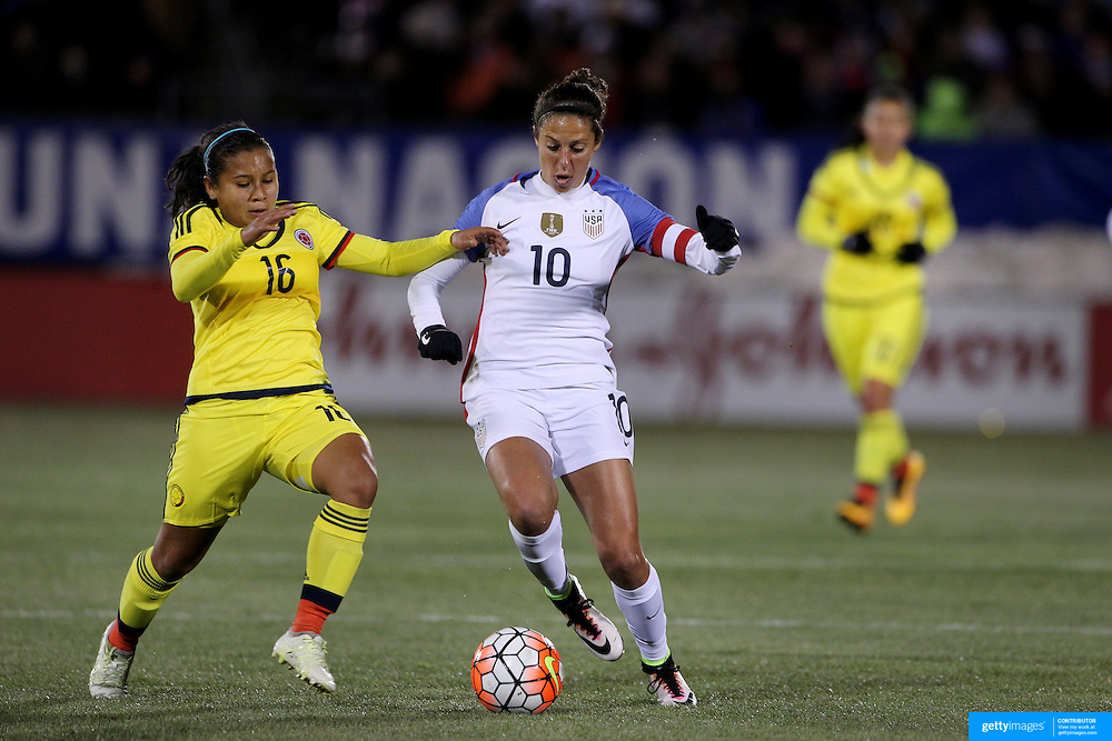Carli Lloyd, USA, is challenged by Leicy Santos, (left), Colombia, during the USA Vs Colombia, Women's International friendly football match at the Pratt & Whitney Stadium, East Hartford, Connecticut, USA. 6th April 2016. Photo Tim Clayton