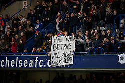 "LONDON, ENGLAND - Sunday, February 6, 2011: Liverpool supporters with a banner: ""He who betrays will always walk alone"" in referece to Fernando Torres joining Chelsea during the Premiership match at Stamford Bridge. (Photo by David Rawcliffe/Propaganda)"