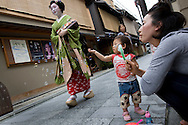 Miehina, a 20 year old maiko ( an apprentice geisha) from the Miyagawacho district of Kyoto, makes her way through the streets to her evening appointment with clients in a tea house, Japan, Sunday, May 18th 2008.