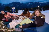 Girls at Whistler Blackcomb Tube Park, winter Girls tubing, Whistler Blackcomb Tube Park, Whistler, BC