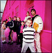 Ian Brown, Manchester 1990s. Shot on a street in Moss Side, painted pink for a Barbie commercial