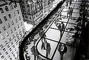 Street scene with people walking reflected in mirrored roof Madrid, Gran Via
