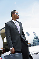 Business Man Beside an Airplane