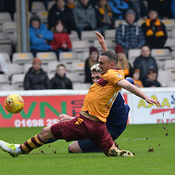 Tom Aldred (Motherwell) blocks a shot from Kyle Lafferty (Hearts) during the Scottish Cup quarter final between Motherwell and Hearts at Fir Park, where the home side made it into the semi final draw with a win.<br /> <br /> (c) Dave Johnston | sportPix.org.uk