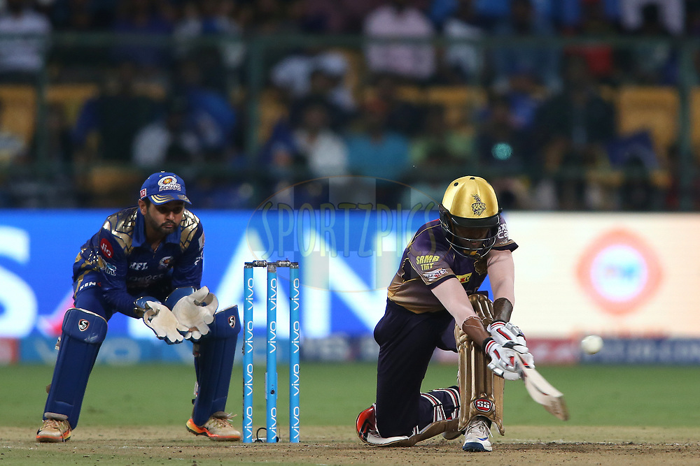 Suryakumar Yadav of the Kolkata Knight Riders sweeps a delivery to the boundary during the 2nd qualifier match of the Vivo 2017 Indian Premier League between the Mumbai Indians and the Kolkata Knight Riders held at the M.Chinnaswamy Stadium in Bangalore, India on the 19th May 2017<br /> <br /> Photo by Shaun Roy - Sportzpics - IPL
