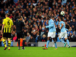 Manchester City's Yaya Toure is booked for throwing the ball away - Photo mandatory by-line: Joe Meredith/JMP  - Tel: Mobile:07966 386802 03/10/2012 - Manchester City v Borussia Dortmund - SPORT - FOOTBALL - Champions League -  Manchester   - Etihad Stadium -