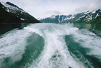 Large wake of boat in the water of Holgate Arm Fjord off Kenai Peninsula Alaska USA