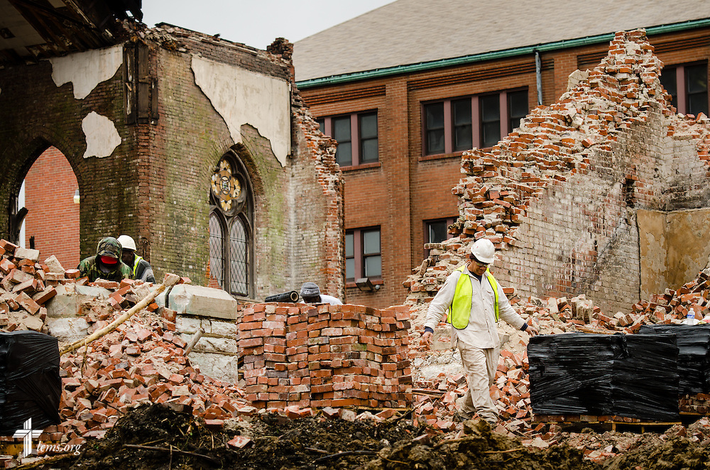 Workers remove debris from Bethlehem Lutheran Church in north St. Louis on Monday, April 14, 2014. The 119 year-old church collapsed on Friday evening.  LCMS Communications/Erik M. Lunsford