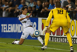 July 20, 2011; Santa Clara, CA, USA;   Vancouver Whitecaps midfielder Shea Salinas (22) is defended by San Jose Earthquakes goalkeeper Jon Busch (18) during the second half at Buck Shaw Stadium. San Jose tied Vancouver 2-2.