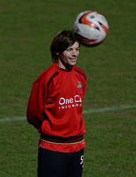 © London News Pictures. 26/02/2014. Doncaster, UK. One Directions Louis Tomlinson warms up ahead of his debut for Doncaster reserves against Rotherham at the Keepmoat Stadium in Doncaster 26 February 2014 . Photo credit: London News Pictures.