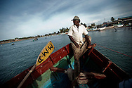 Commercial fisherman bring their catch to shore in Trincomalee, Sri Lanka, Wednesday, June 30, 2009.With the end of the 26 year old war between the Sri Lankan government and the LTTE, restrictions on fishing lanes have eased, allowing commercial fishers more time in the water to bring in their catch.