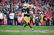 GLENDALE, AZ - JANUARY 01:  Quarterback DeShone Kizer #14 of the Notre Dame Fighting Irish runs during the first quarter of the BattleFrog Fiesta Bowl against the Ohio State Buckeyes at University of Phoenix Stadium on January 1, 2016 in Glendale, Arizona.  (Photo by Jennifer Stewart/Getty Images)
