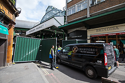 © Licensed to London News Pictures. 12/06/2017. London, UK. A delivery van enters Borough Market as traders begin clearing up and prepare to reopen. The market was the scene of a terrorist attack on Saturday 3 June 2017 in which eight people were killed. Photo credit: Rob Pinney/LNP