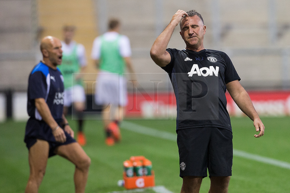 © Licensed to London News Pictures . 15/08/2016 . Leigh , UK . Manchester United Manager WARREN JOYCE slaps his forehead following a missed opportunity by United . Manchester United vs Leicester City reserves at Leigh Sports Village Stadium . Photo credit : Joel Goodman/LNP