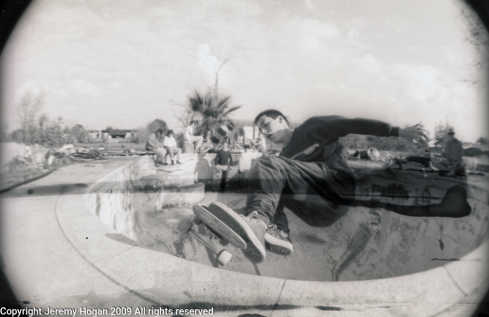 Tom Knox, not yet a professional skateboarder, skateboards in an abandoned swimming pool on the outskirts of Visalia, California in 1987.