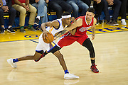 Golden State Warriors guard Patrick McCaw (0) dribbles down the court during a NBA preseason game against the Los Angeles Clippers at Oracle Arena in Oakland, Calif., on October 4, 2016. (Stan Olszewski/Special to S.F. Examiner)