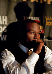 The shadow of Don King looms over Floyd Mayweather at the press conference announcing his upcoming fight against Zab Judah.  The fight will take place on April 8, 2006 in Las Vegas.