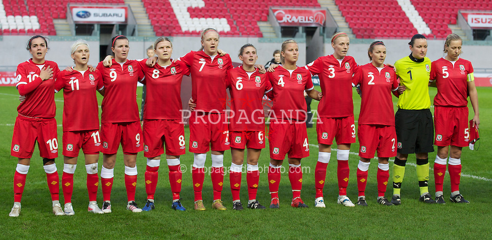 LLANELLI, WALES - Saturday, October 22, 2011: Wales' players line-up before the UEFA Women's EURO 2013 Qualifying Group 4 match against France at Parc Y Scarlets. L-R: Gwennan Harries, Jessica Fishlock, Helen Lander, Michelle Green, Helen Bleazard, Amie Lea, Kylie Davies, Sophie Ingle, Loren Dykes, Nicola Davies, Jayne Ludlow. (Pic by Gareth Davies/Propaganda)
