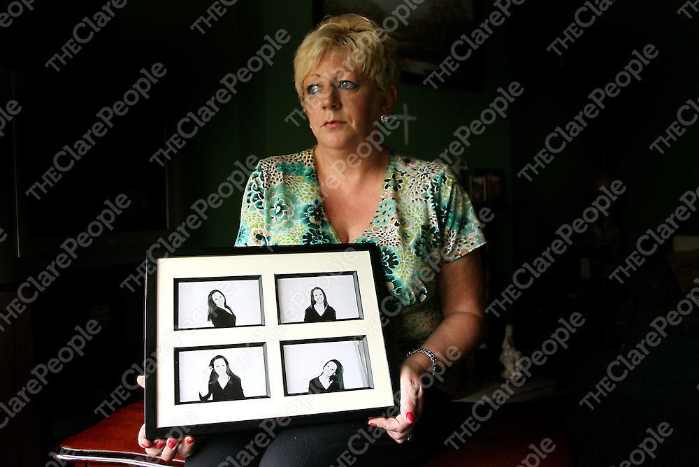 Carol Finn holding photographs of her 19 year old daughter Sarah who committed suicide on the 21st of June last.<br /> Photograph by Yvonne Vaughan