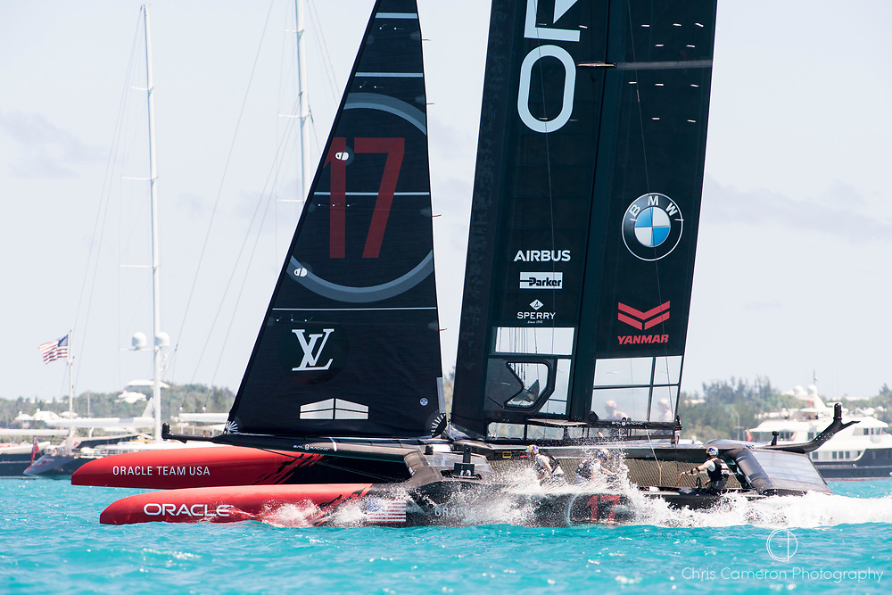 The Great Sound, Bermuda, 25th June 2017. Oracle Team USA fall off the foils at the bottom mark while trying to gybe Emirates Team New Zealand lead all the way around the course. Day four of racing in the America's Cup presented by Louis Vuitton.