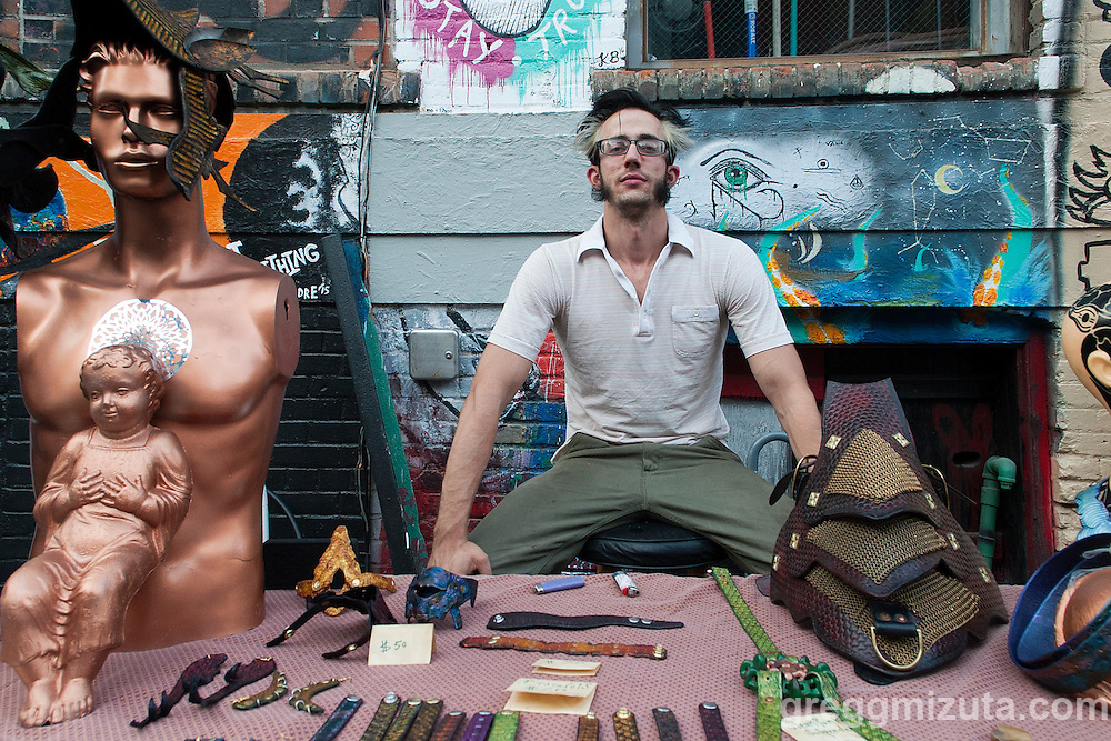 Rafferty Bingham with his custom leather works at Freak Alley Gallery's sixth annual mural event in downtown Boise, Idaho on August 13, 2016. <br /> <br /> Freak Alley Gallery's week long event from August 6th - 13th, provided an &quot;art-in-motion&quot; experience as it welcomed the public to watch artists work on their murals.