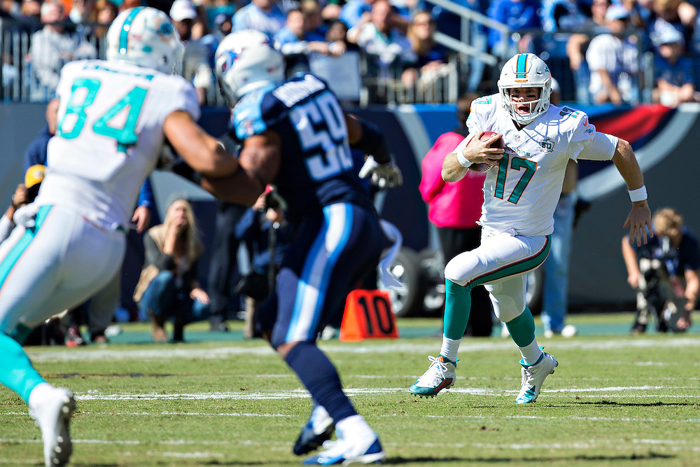NASHVILLE, TN - OCTOBER 18:  Ryan Tannehill #17 of the Miami Dolphins runs the ball during a game against the Tennessee Titans at LP Field on October 18, 2015 in Nashville, Tennessee.  The Dolphins defeated the Titans 38-10.  (Photo by Wesley Hitt/Getty Images) *** Local Caption *** Ryan Tannehill
