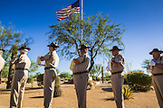 08 OCTOBER 2013 - PHOENIX, AZ: Members of a Veterans of Foreign Wars Honor Guard carry urns containing the cremated remains of unclaimed military veterans past an American flag at the National Memorial Cemetery in Phoenix. The cremated remains of 36 unclaimed US military veterans were interred at the National Memorial Cemetery in Phoenix. Members of the US military and several hundred veterans of the US military attended the service, which was a part of the Missing In America Project (MIAP).     PHOTO BY JACK KURTZ