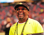 New Orleans Saints head coash Sean Payton shares a laugh with Filmamaker Spike Lee on the sideline, just prior to the kick off to the popening of the NFL season. The Saints beat the Minnessota Viking 14-9- in New Orleans at the Super dome Thursday Sept. 9 2010. Phot © Suzi Altman