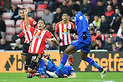 Leicester City's midfielder Andy King (10) brings down Steven Pienaar (20) Sunderland AFC midfielder  during the Premier League match between Sunderland and Leicester City at the Stadium Of Light, Sunderland, England on 3 December 2016. Photo by Ian Lyall.
