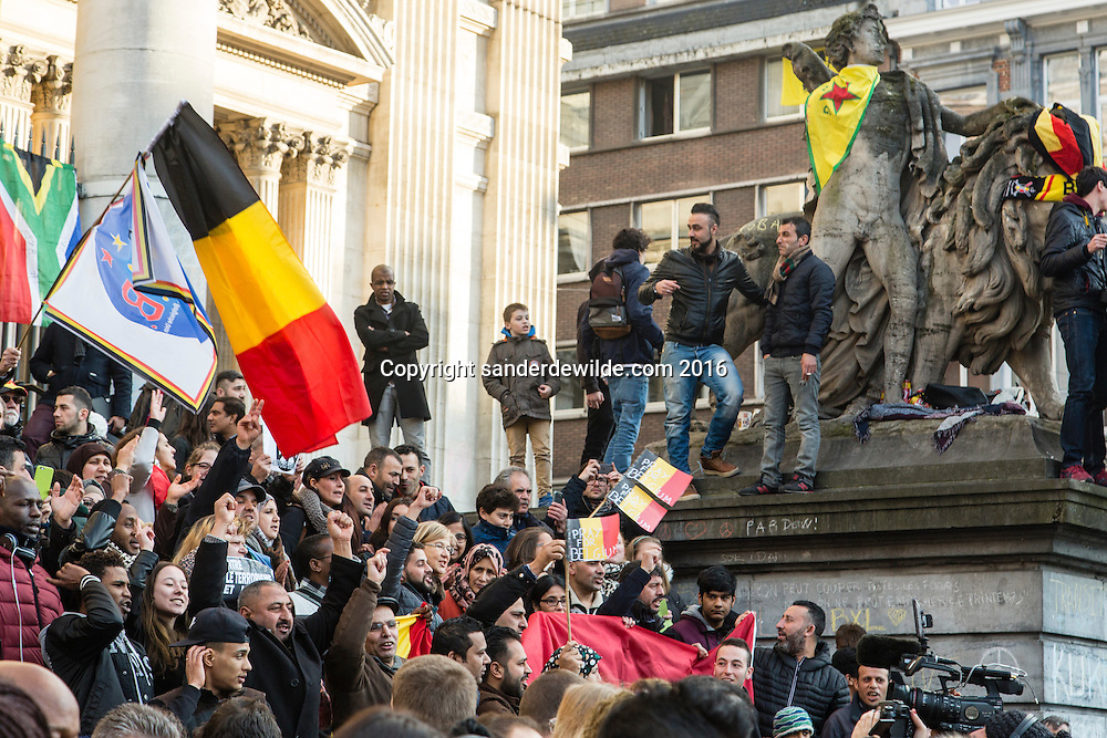Brussels 23 March 2016. People from Brussels gathered at the Beurs square in the center of town to remember the victims of the terrorist attacks at Zaventem and Maalbeek underground station.