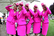 The York Racecourse Pink Lady Team holding on to their fascinator hats in the wind prior to the Ebor Festival at York Racecourse, York, United Kingdom on 22 August 2019.