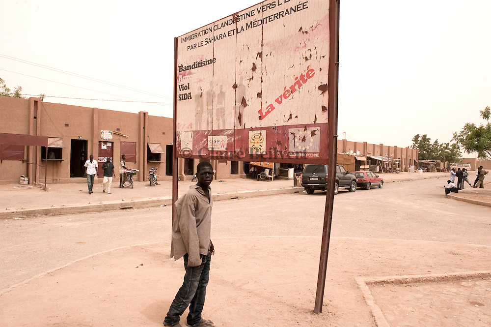 """A warning sign from the European Community in Agadez' bus station about illegal migrants :  """" illegal immigration to Europe through Sahara and mediterranean see, Bantitism, Agression, Rape, Aids, the Truth."""""""