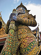A yak with fangs guards the Temple of the Emerald Buddha (Wat Phra Kaew) within the grounds of the Grand Palace in Bangkok, Thailand. In Thailand, a yak is a giant demon (ogre, colossus, monster, or titan) from the Ramakian (the Thai version of the Hindu Ramayana epic mythology). (In India, a yaksha male can sometimes be a fearsome warrior; a yakshi/yashini female is usually a benevolent nature spirit.) The Grand Palace (or Phra Borom Maha Ratcha Wang, in Thai) was built on the east bank of the Chao Phraya River starting in 1782, during the reign of Rama I. It served as the official residence of the king of Thailand from the 1700s to mid 1900s.