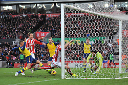 Arsenal's Kieran Gibbs manages to clear the ball away from a goalmouth scramble - Photo mandatory by-line: Dougie Allward/JMP - Mobile: 07966 386802 - 06/12/2014 - SPORT - Football - Stoke - Britannia Stadium - Stoke City v Arsenal - Barclays Premie League