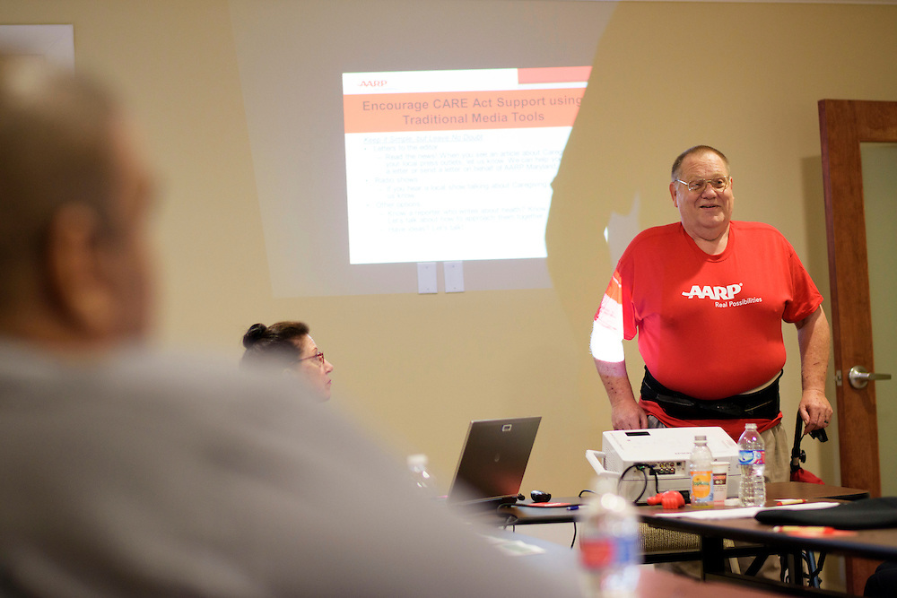 Annapolis, Maryland - May 21, 2015: John Hankel, 61, from Baltimore, teaches fellow legislative advocates how to talk to Maryland law makers about reinstitution the CARE act at an AARP office in Annapolis, Thursday May 21, 2015. Hankel, 61, is a wounded veteran from the Vietnam War era who uses Maryland's Medicaid services. <br /> Other legislative advocates are (foreground to background) Christopher Moore, and Renee Frederickson.<br /> <br /> CREDIT: Matt Roth