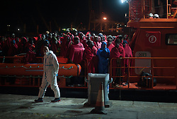 November 22, 2018 - Malaga, Spain - Migrants stand on a rescue vessel as they wait to disembark after their arrival at the Port of Malaga. Spain's Maritime Rescue service rescued 201 migrants aboard  dinghies at the Alboran Sea and brought them to Malaga harbour where they were assisted by the Spanish Red Cross. According with the Spain's Maritime Rescue Service, 14 migrants are unknown whereabouts while they travelled onboard a small dinghy at the sea toward the Spanish coast. (Credit Image: © Jesus Merida/SOPA Images via ZUMA Wire)